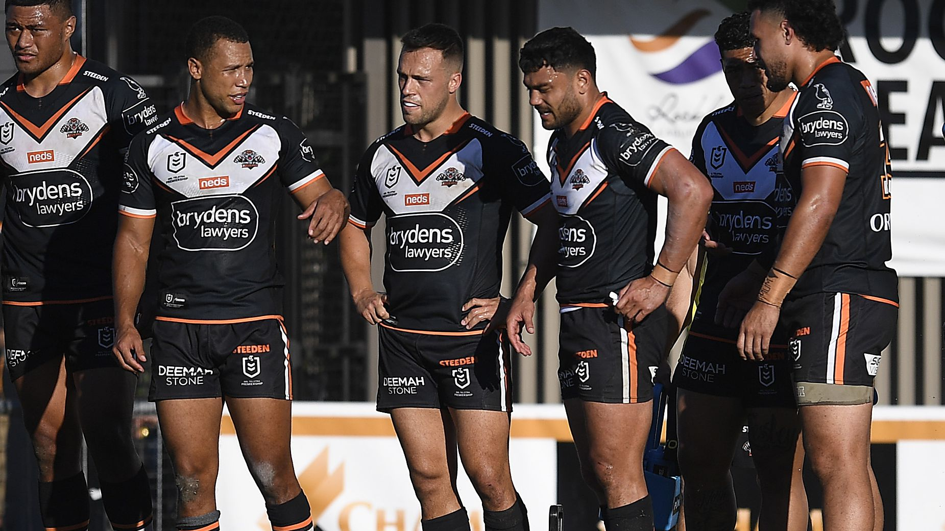 The Tigers look on after a Sharks try.