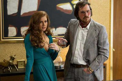 For her performance in <i>American Hustle</i>.