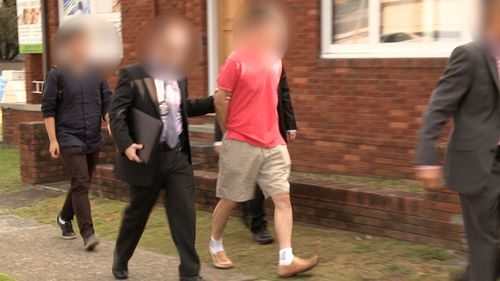 Australian Federal Police officers arrest a man during operation BYAHAUT. The 59-year-old Sydney man was allegedly acting as an economic agent for the North Korea. (AAP)