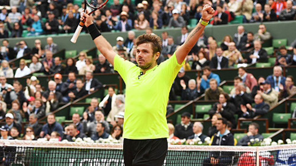 Stan Wawrinka celebrates his hard-fought win. (Getty)
