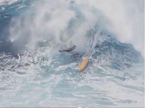 Surfer cartwheels down monster wave