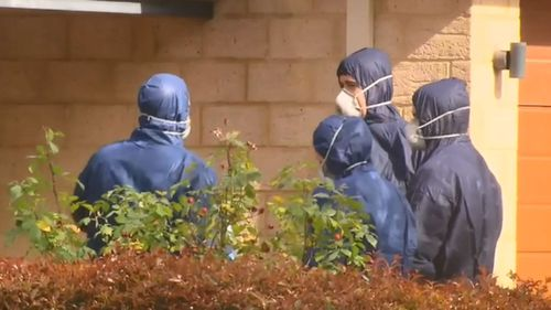 Forensic police at the property were Fahima Yusuf's body was found.