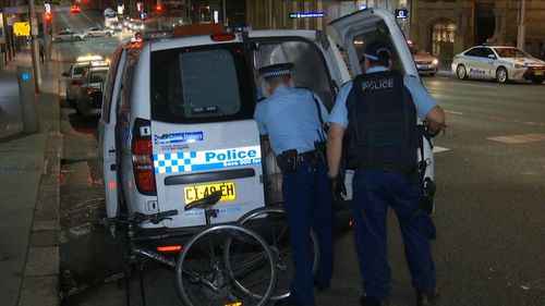 Police attend the scene of a reported assault in Sydney's CBD.
