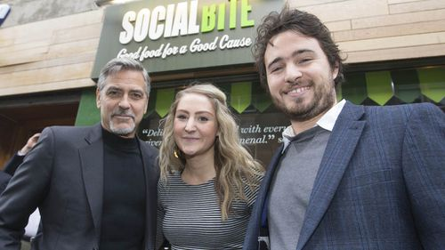 George Clooney during a visit to Social Bite sandwich shop, where he met owners Alice Thompson & Josh Littlejohn. (Getty)