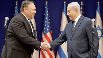 U.S. Secretary of State Mike Pompeo, left, shakes hands with Israeli Prime Minister Benjamin Netanyahu, during a meeting at the Prime Minister's residence in Jerusalem