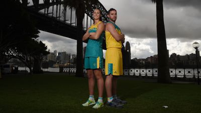 Basketballers Stephanie Talbot and Adam Gibson model their Adidas uniforms.