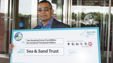 A carpenter who won $346m in Powerball says he won't quit his job.