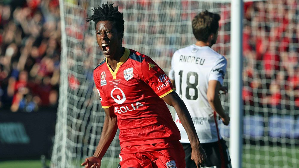 Bruce Kamau celebrates his goal for United. (Getty)