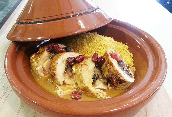 Middle Eastern turkey tagine with carrot couscous and rose petals