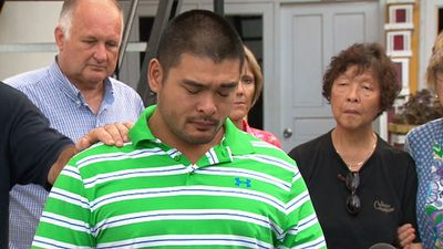 Michael Chan is comforted as he speaks about his brother Andrew's last hours on death row. (9NEWS)