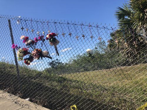 Flowers are tied to the school fence in tribute. Picture: Lizzie Pearl