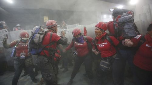 Protesters in Mexico City are pepper-sprayed.