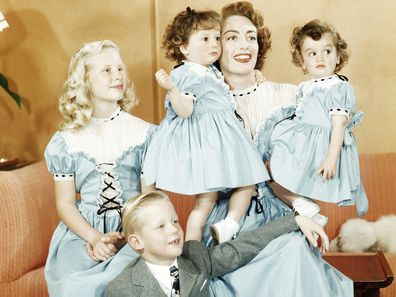 Joan Crawford with her daughter Christina, her son Christopher and her adopted, identical twin daughters, Cindy and Cathy, circa 1949
