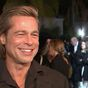 Brad Pitt seems thrilled when asked if Jennifer Aniston is his Oscars date