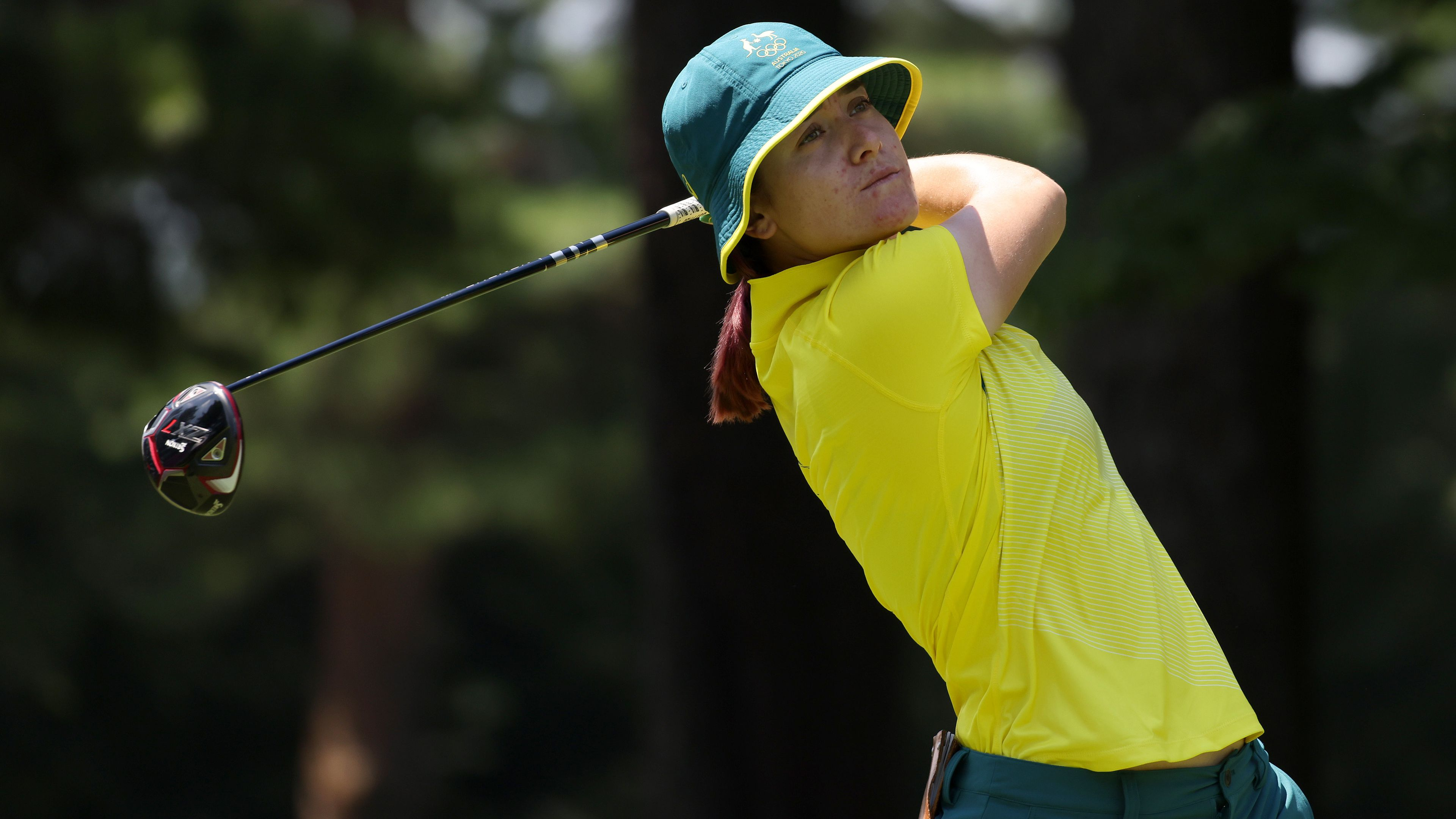 Australian golfer Hannah Green closes in on bronze medal as tropical storm approaches Tokyo