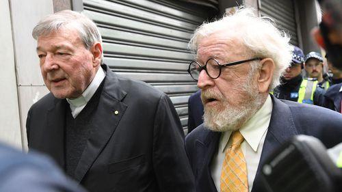 Cardinal George Pell(Left) aside Barrister Robert Richter