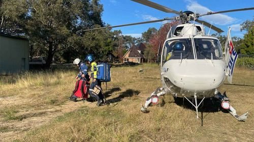 CareFlight personnel arrive at the scene in Kenthurst.