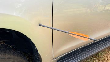 Northern Territory Police are investigating potential criminal damage charges after a car was impaled with a crossbow bolt south of Darwin.