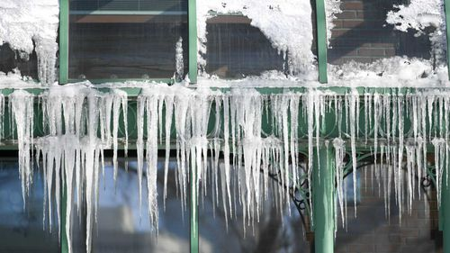 Sub-zero temperatures produce icicles that hang from a restaurant in Minneapolis, Minnesota.