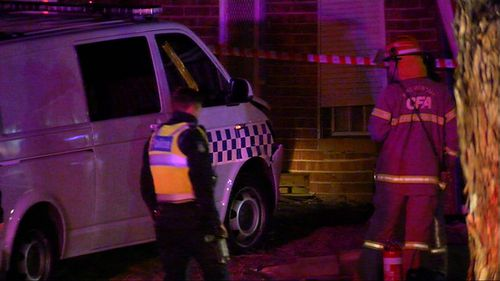 A police van crashed into the side of a house while responding to a house fire. Image: 9News