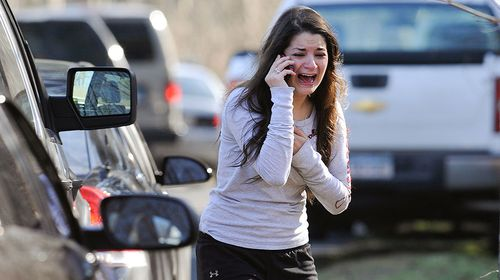 A woman waits to hear about her sister, who is a teacher at Sandy Hook. (AAP)