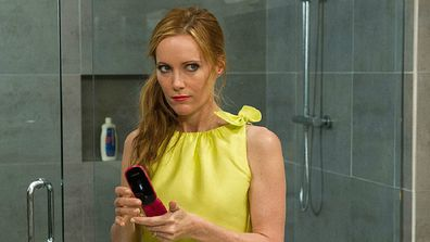 Wife checks phone in the movie The Other Woman distributed by 20th Century Fox.