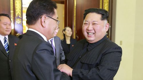 Kim Jong Un, left, shakes hands with South Korean National Security Director Chung Eui-yong in Pyongyang, North Korea.  (AAP)