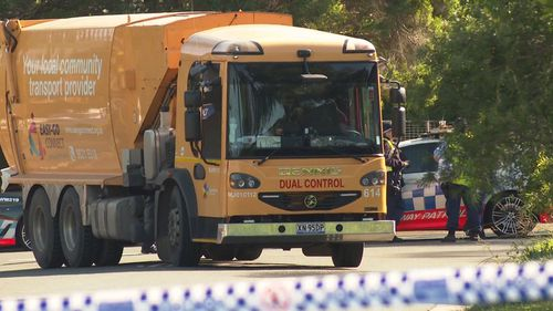A woman has died in Sydney's west after being struck by a garbage truck.