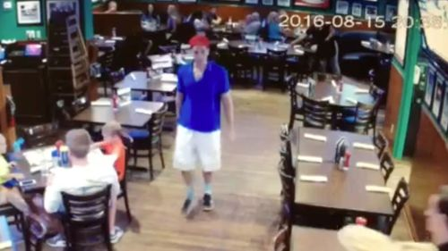 This image made from a video released Friday, August 19, 2016, by Duffy's Sports Grill, shows Austin Harrouff leaving the restaurant in Jupiter, Florida.