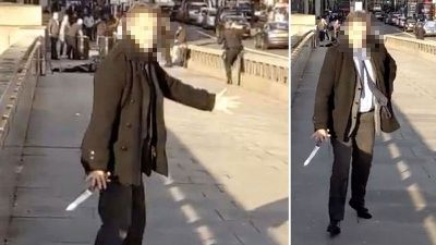 Stills taken from footage of the incident shows one of the heroes, dressed in a dark overcoat and tie, emerging from the scuffle with what appears to be a knife the suspect had been wielding.