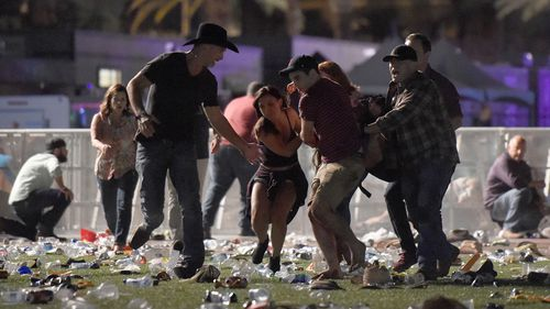 Festivalgoers are seen running from the event at the Mandalay Bay Resort and Casino. (Getty Images)