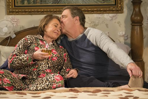 Barr and Roseanne co-star John Goodman on set of the recently rebooted show. Picture: AAP