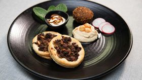 The Shahrouk's lahma bi agin, falafel, hummus bi tahini with mint, radish and tahini pomegranate molasses dip