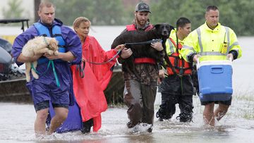 Texans refuse to abandon pets as they flee floodwaters