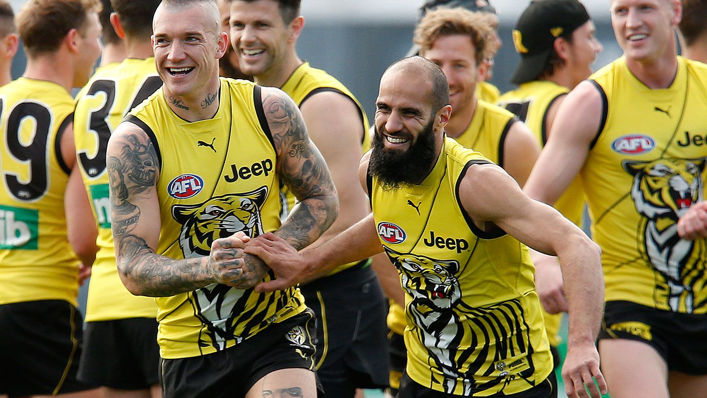 Dustin Martin and Bachar Houli of the Tigers share a joke during a Richmond Tigers AFL training