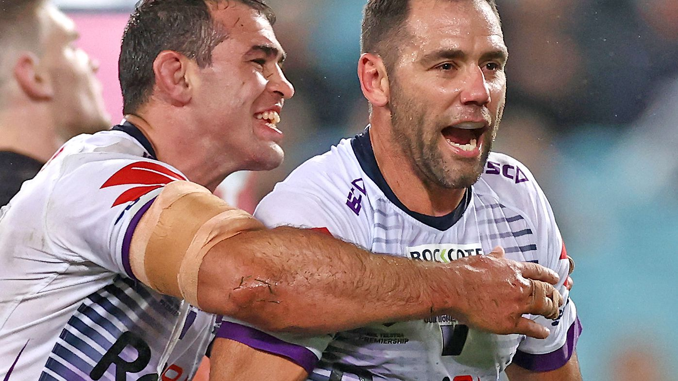 Cameron Smith of the Storm celebrates with team mates after scoring a try