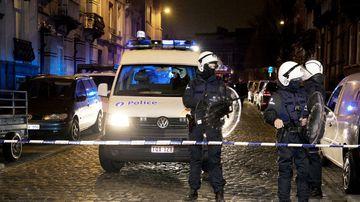 Policemen stand guard the street at Rue de la Carpe in Molenbeek-Saint-Jean in Brussels, on March 19, 2016, following the arrest of five people in counter-terror raids in Brussels a day earlier. (AFP)