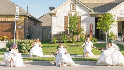 Jamie Egloff, Bryce Ellerbroek, Shannon Thomas, Nina Wagner and Jaime Sladek from Georgetown, Texas pose in their wedding dresses for fun social distancing photoshoot by neighbour Elyssa Seibel