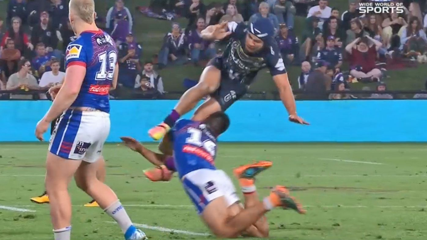 Jahrome Hughes is taken out while kicking