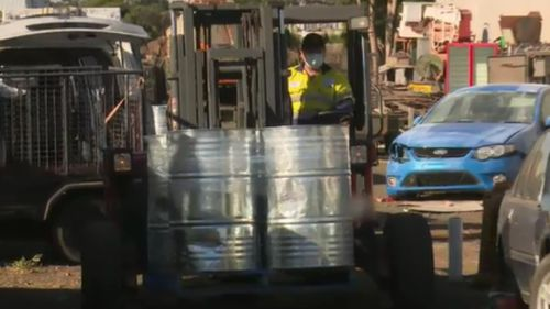 A fork-lift was used in the raids. (9NEWS)