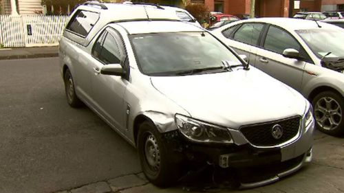 Driver on the run after ramming two police cars in Melbourne's north, injuring an officer