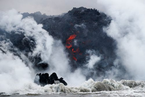 The people were aboard a tour boat that takes visitors to see lava plunging into the ocean from a volcano that has been erupting for two months. Picture: AP