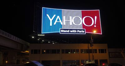 A Yahoo billboard has been illuminated in the French national colours in solidarity with the victims of the deadly terrorist Paris attacks, in downtown San Francisco, California. (AAP)
