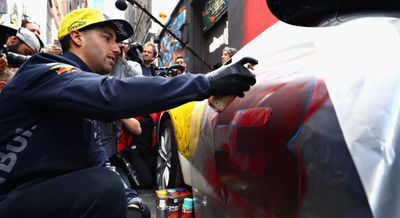 'Throwing paint around on the streets of Melbourne': Daniel Ricciardo sprays paint in Melbourne's famous laneways. (Twitter)