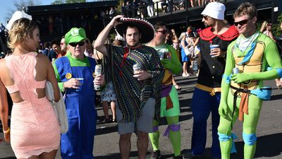 <p>Many colourful costumes were spotted among the more traditional racewear choices. (AAP)</p>