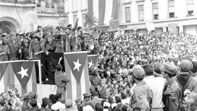 In this Jan. 1959  photo, Cuba's leader Fidel Castro addresses a crowd in a park in front of the presidential palace in Havana, Cuba. (AAP)