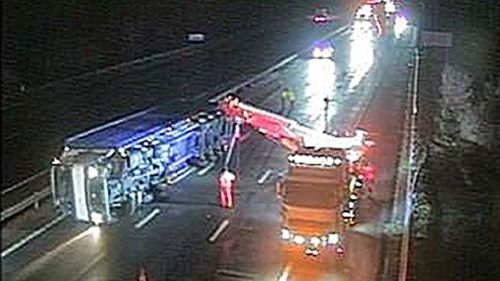 CCTV still issued by Highways England of an overturned truck between J9-J8 on the M5 as Storm Eleanor lashed the UK. (AAP)