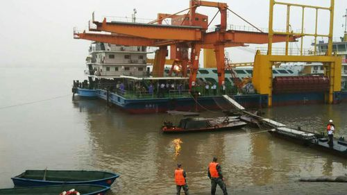 Cyclonic weather hampers rescue effort after ship carrying 458 people sinks in China's Yangtze River