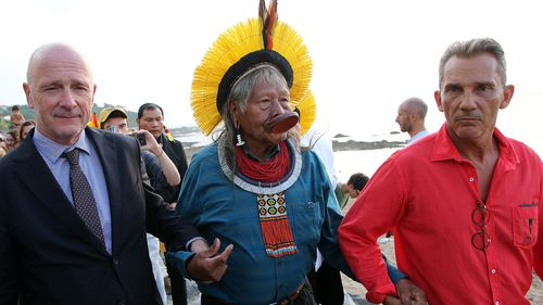 Kayapo tribal leader Raoni Metuktire holds hands with Emmanuel Alzuri, left, the mayor of Bidart and Marcos Foster, right, city councilor in Bidart, southwestern France, as they arrive for a press conference on Monday, Aug. 26, 2019. Raoni, the figurehead of the fight against deforestation in the Amazon, said that he met French President Emmanuel Macron on Monday evening after the G-7 summit ended in nearby Biarritz.
