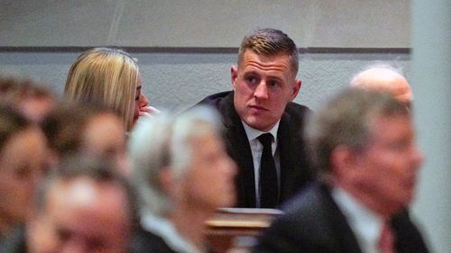 American Football player J.J. Watt arrives before the funeral service.